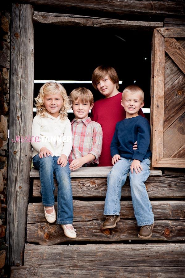 4 siblings sitting in window