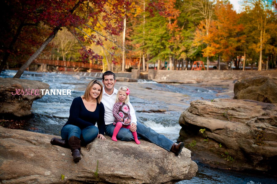 Family portrait on river rocks at the park
